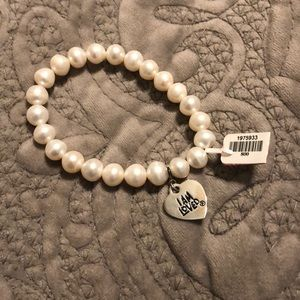 Faux pearl bracket with heart charm
